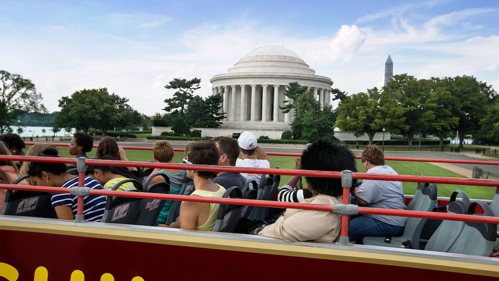 Double decker bus driving past the Jefferson Memorial in Washington DC