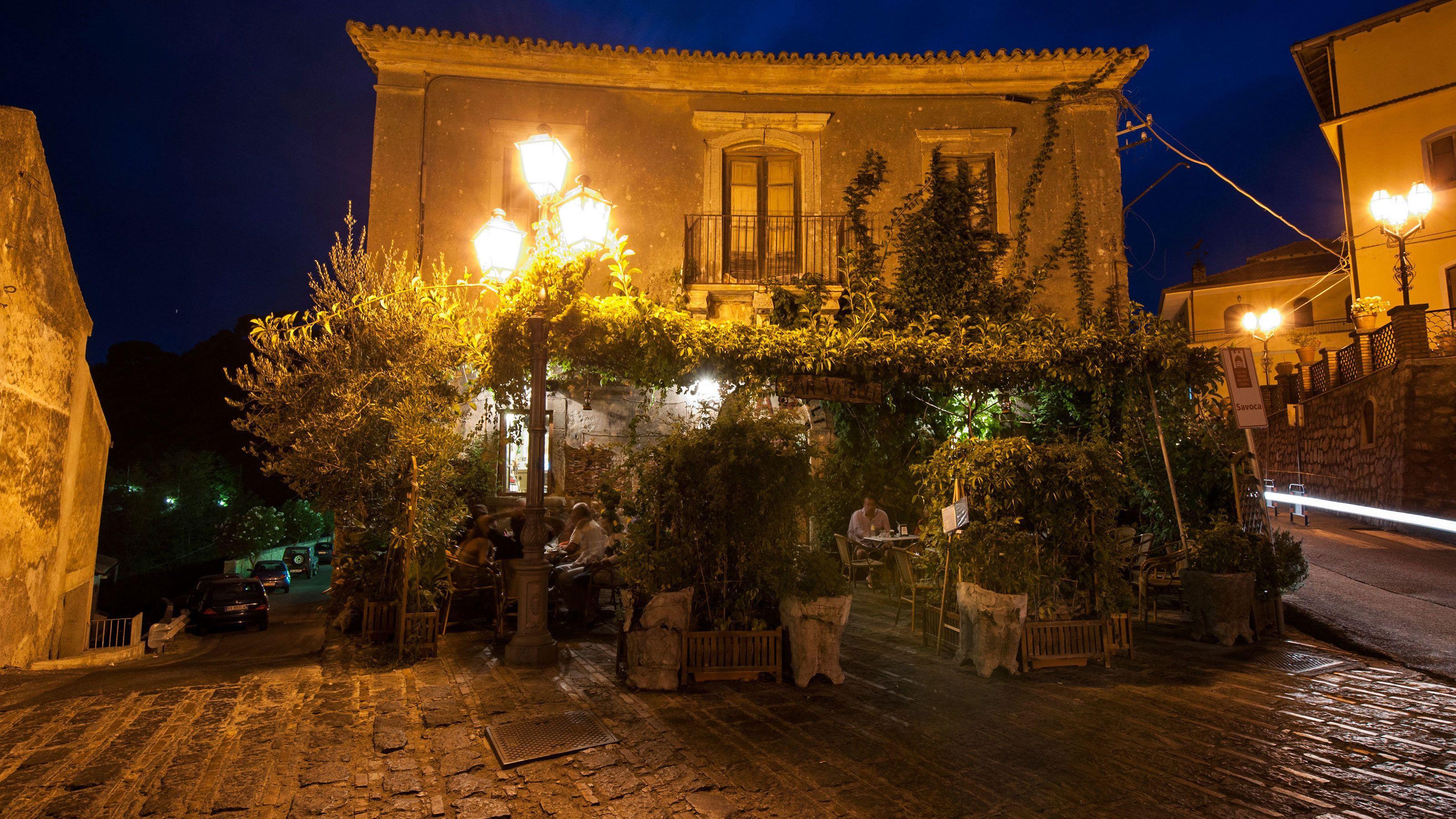 Outdoor cafe at night in Taormina