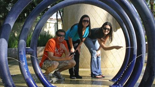 Friends posing near landmark in San Luis Obispo