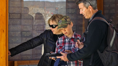 Family looking at guide in San Luis Obispo