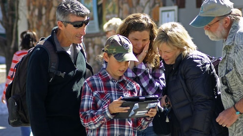 Family looking at guide in in San Luis Obispo