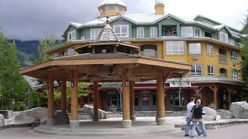 Couple walks past Bear Lodge in Whistler Village BC