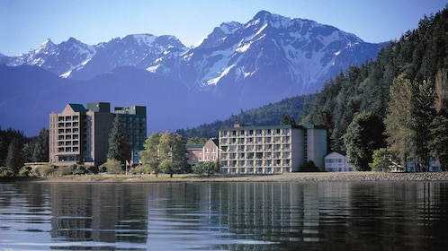 Resort on a lake with mountains in the background in Vancouver