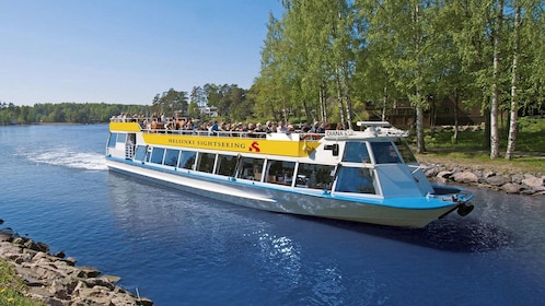 Double-decker tour boat on a canal in Helsinki