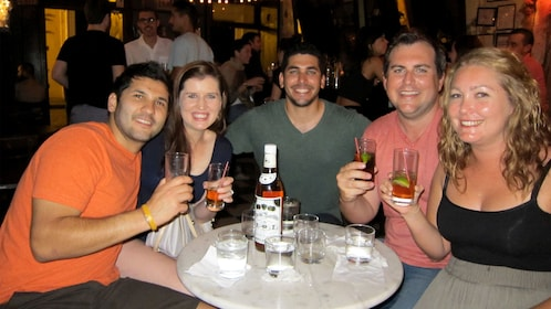 Group with cocktails at a table in Puerto Rico