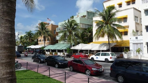 Oceanfront street with colorful buildings in Miami
