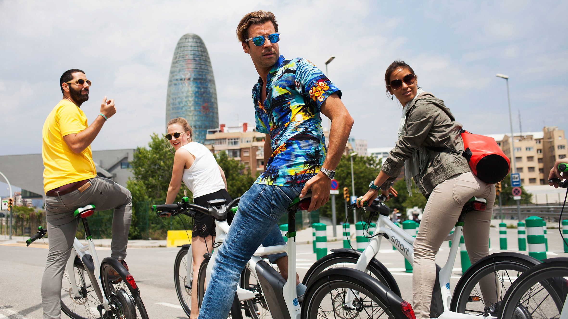 Group on ebikes with the Agbar Tower in the background in Barcelona