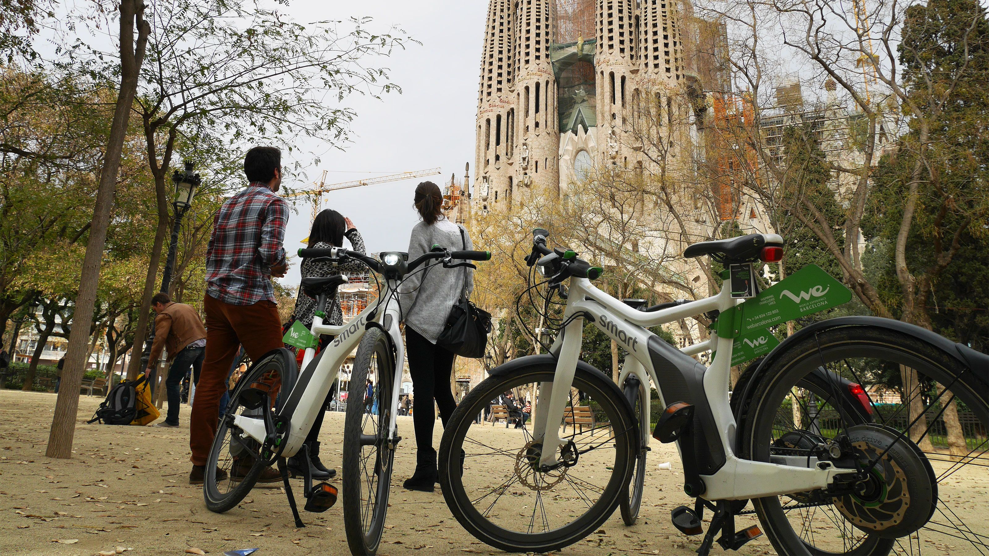 Group with parked ebikes at La Sagrada Familia in Barcelona