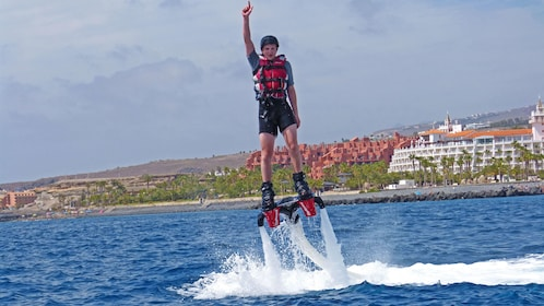 Flyboarding man shoots into the air from the water in Tenerife