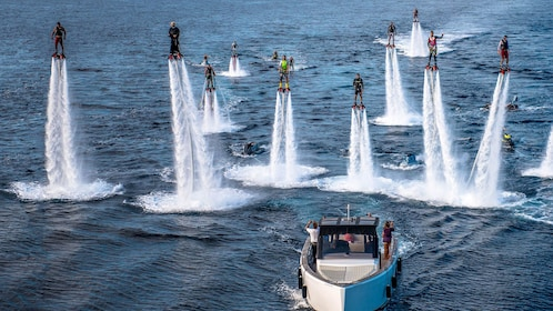 Group on flyboards over the water in Tenerife