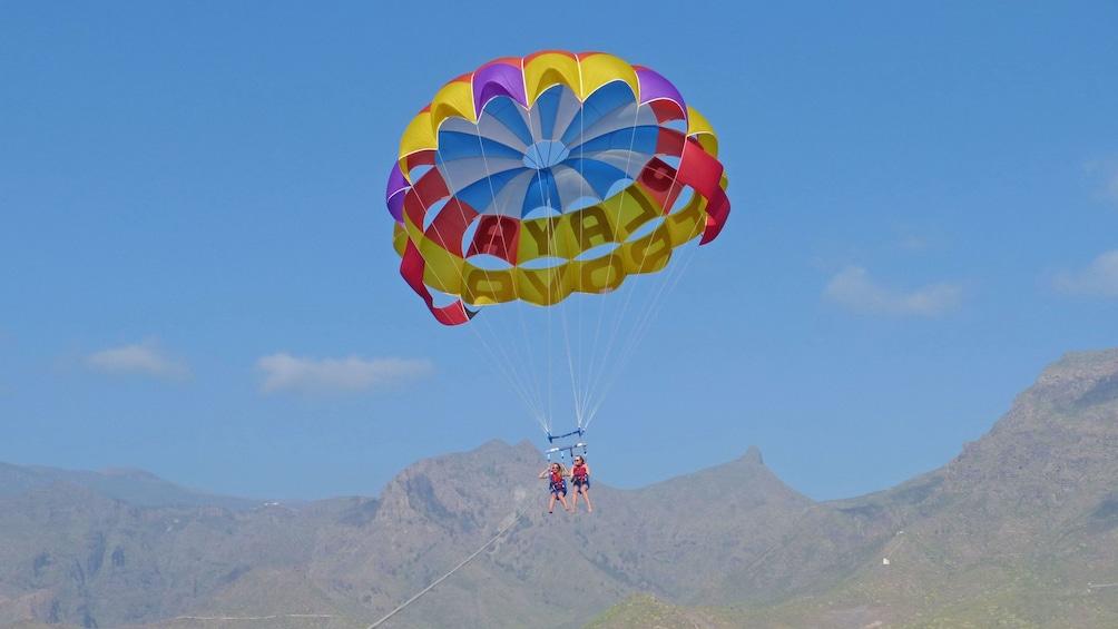 Couple parascending in Spain