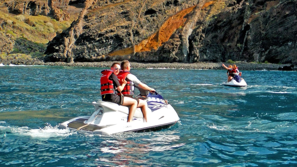 Show item 3 of 5. Jet ski group exploring the coast in Spain