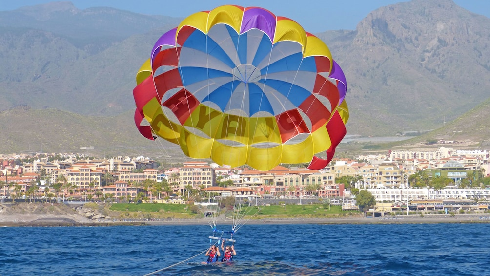 Parascending coasting into the water in Spain