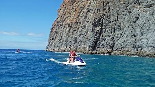 Jet ski along rock formations in Spain