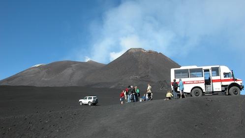 Tour group with shuttle van near Mount Etna