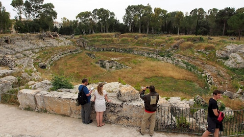 Tour group at the Roman ampitheater ruins in Syracuse