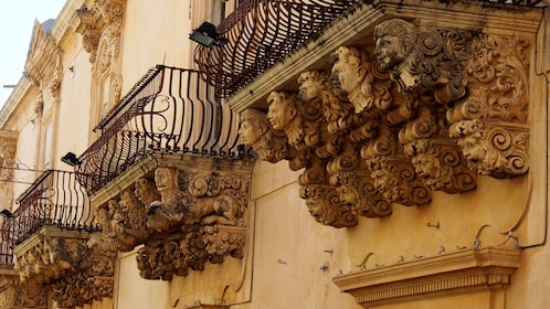 Sculptured balconies of Villadorata Palace in Noto