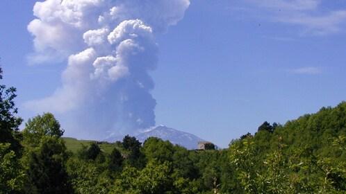 Smoke billowing from Mount Etna in Taormina