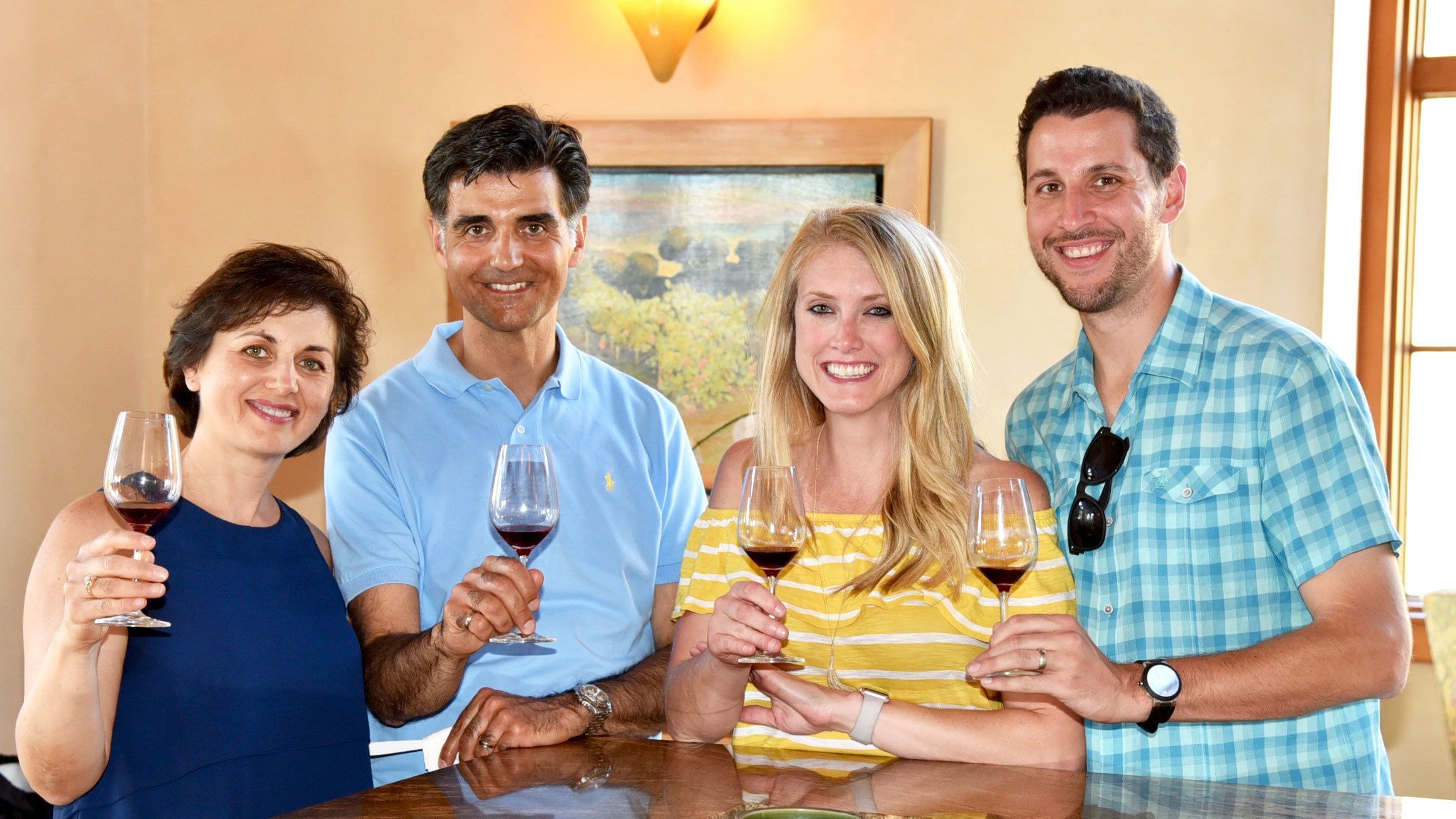 Two couples enjoying wine tasting at winery in Napa Valley