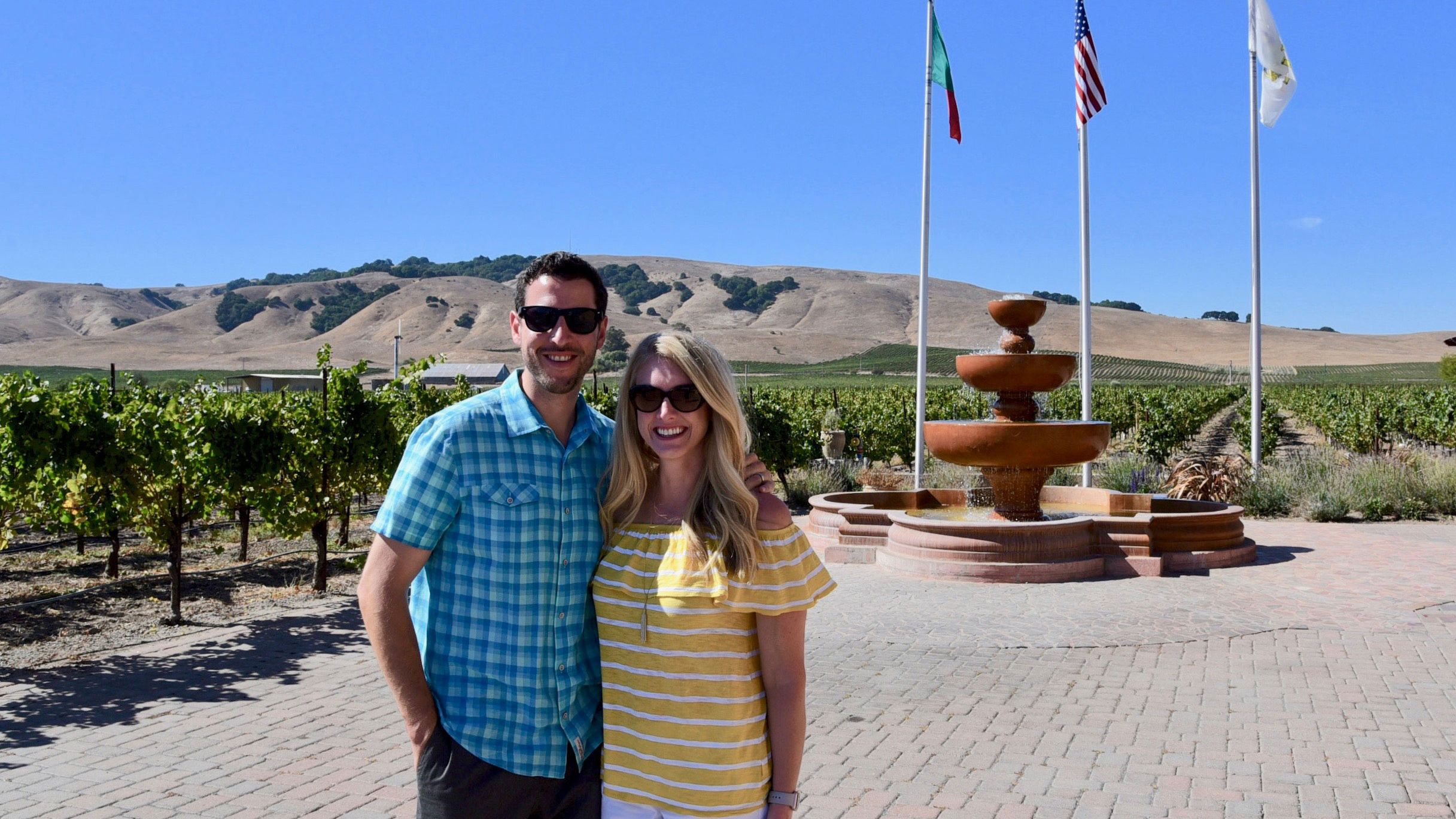 Couple in front of fountain in Napa Valley