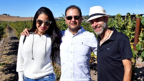 Couple with tour guide in vineyard in Sonoma Valley