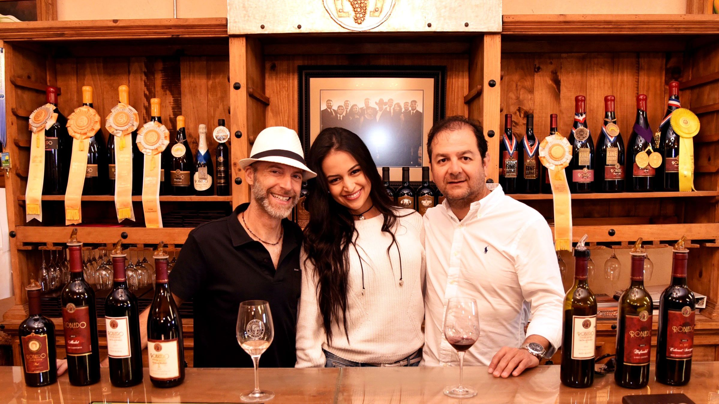 Couple with tour guide in winery in Napa Valley