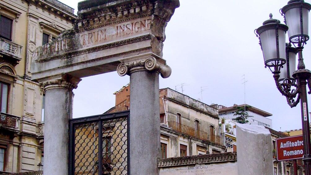 Apri foto 3 di 7. Outside the ruins of a roman amphitheater in Catania