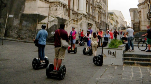 Segway group riding down a street in Catania