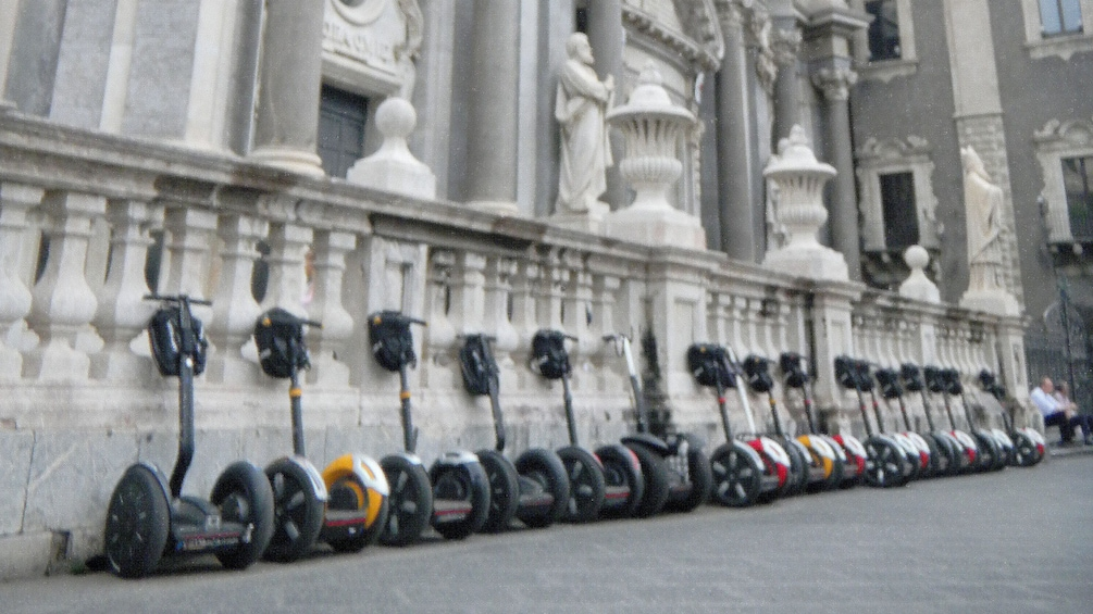 Apri foto 2 di 7. Segways lined up outside a building in Catania