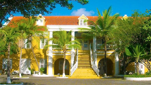 Yellow mansion and palm trees in Bonaire