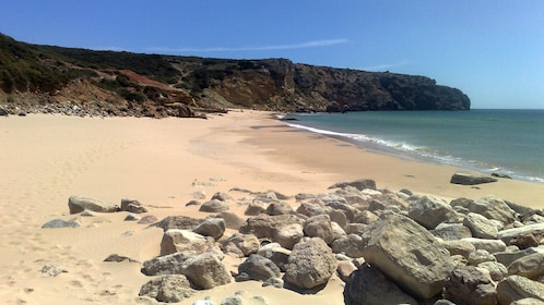 Sandy beach nearby cliffs on the southern coast of Portugal