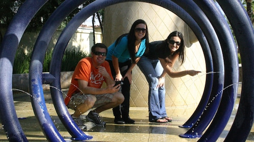 Group looking through a spiral sculpture fountain in Salt Lake City