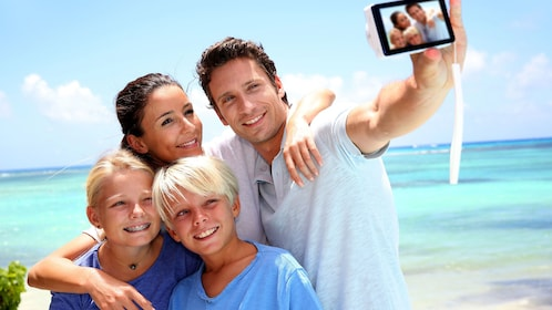 Man taking a selfie with his family on the beach on Kangaroo Island