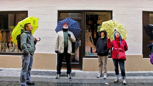 Tour group with umbrellas in Prague
