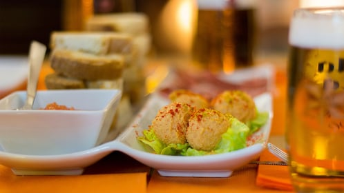 varying appetizers served with beer at a restaurant in Spain
