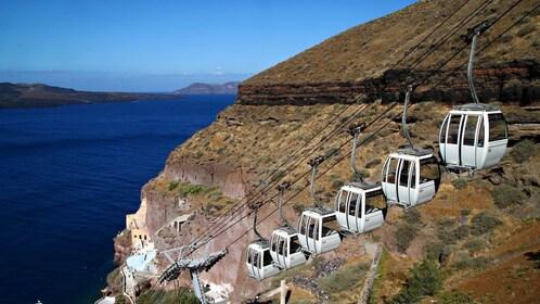 Gondolas going to the top of the mountain on Santorini