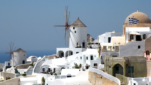 Hilltop windmills and cottages in Oia on the island of Santorini
