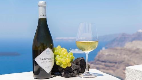 Bottle and glass of Santorini white wine