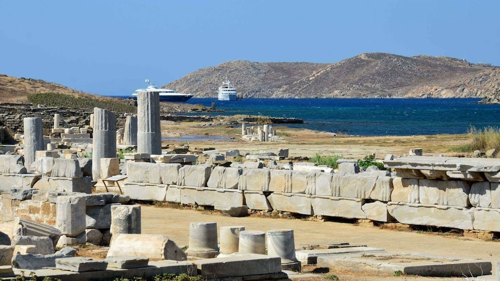 Show item 3 of 5. Temple ruins in Mykonos overlooking the water