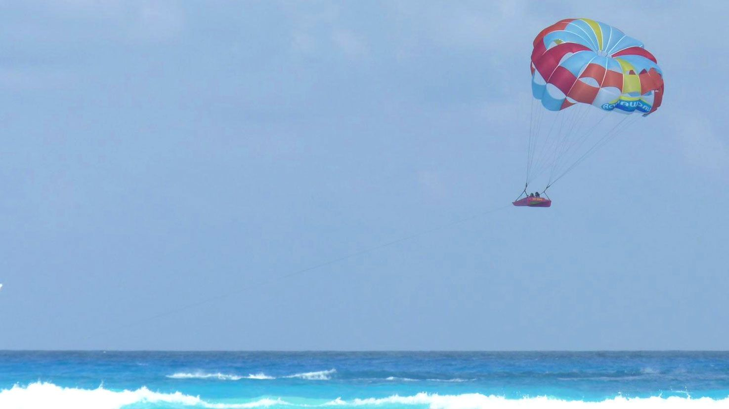 parasailing inside a small raft in Miami