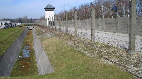 barbed wire fences along a tower at Dacau in Germany