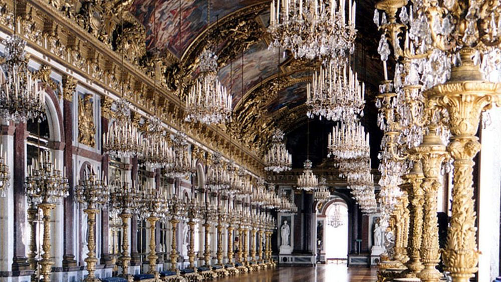 ornamented hallways inside the Herrenchiemsee Castle in Germany