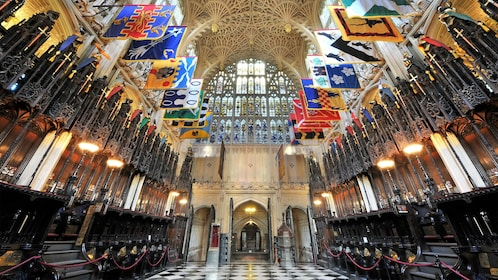 Banners hang from the ceiling in Westminster Abbey in London