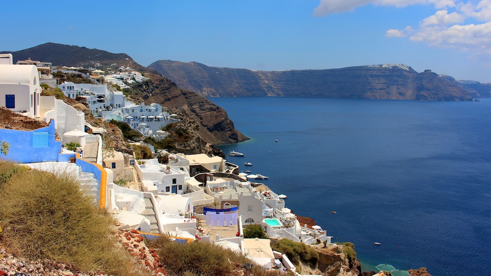 Show item 1 of 5. walking through the coastal steep side of town in Santorini