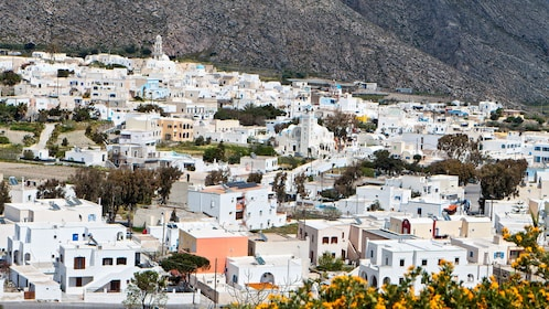 a town of white buildings at Santorini in Greece