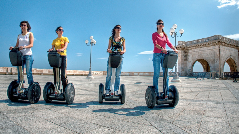 Show item 1 of 5. woman riding segways at Cagliari in Italy
