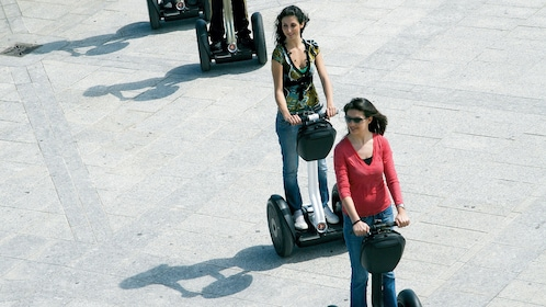 women following one another on their segways in Italy