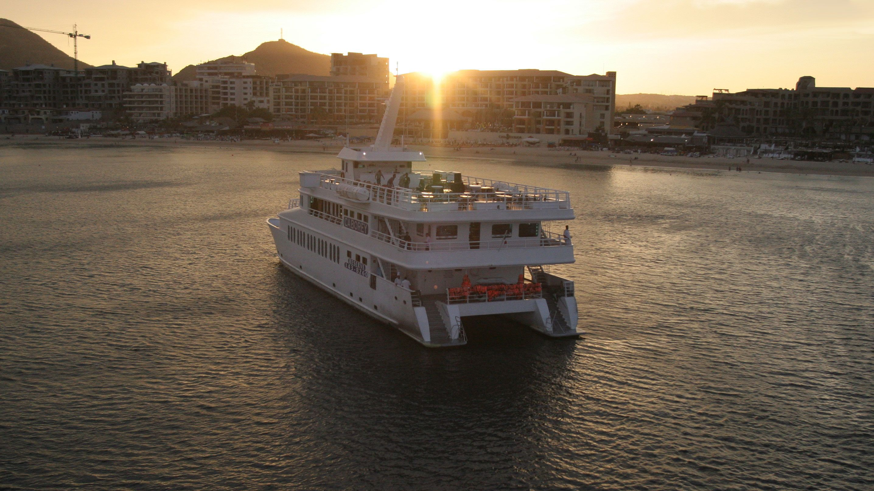 Caborey Sunset Dinner Cruise with Live Music & Entertainment