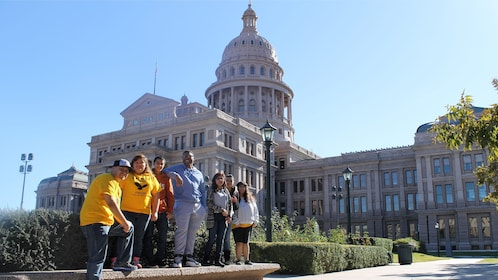 Group posing in front of Texas state capitol building