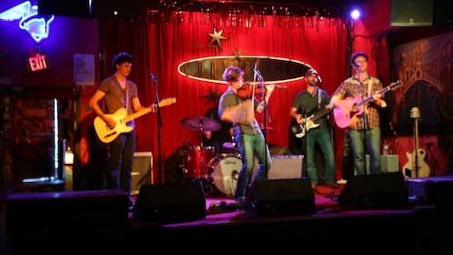 Five-piece band onstage at the Continental CLub in Austin Texas